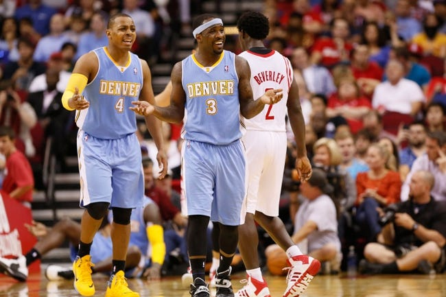 Nov 16, 2013; Houston, TX, USA; Denver Nuggets guard Randy Foye (4) and Ty Lawson (3) react to a call in action against the Houston Rockets during the second half at Toyota Center. The Rockets won 122-111. Mandatory Credit: Soobum Im-USA TODAY Sports