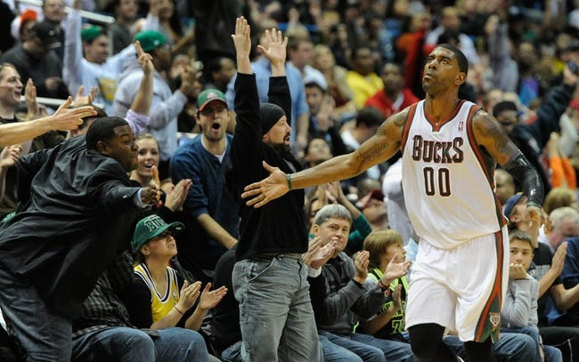 Nov 16, 2013; Milwaukee, WI, USA;  Milwaukee Bucks guard O.J. Mayo (00) shakes hands with fans after hitting a 3-point basket during the game against the Oklahoma City Thunder in the 4th quarter at BMO Harris Bradley Center. Mandatory Credit: Benny Sieu-USA TODAY Sports