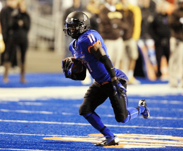 Nov 16, 2013; Boise, ID, USA; Boise State Broncos wide receiver Shane Williams-Rhodes (11) runs for a first down during the first half against the Wyoming Cowboys at Bronco Stadium. Mandatory Credit: Brian Losness-USA TODAY Sports