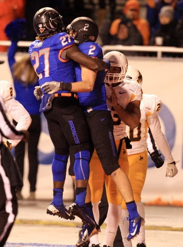 Nov 16, 2013; Boise, ID, USA; Boise State Broncos running back Jay Ajayi (27) and  Matt Miller (2) celebrate Millers touchdown during the first half against the Wyoming Cowboys at Bronco Stadium. Mandatory Credit: Brian Losness-USA TODAY Sports