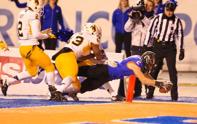 Nov 16, 2013; Boise, ID, USA; Boise State Broncos wide receiver Matt Miller (2) dives into the end zone for a touchdown during the first half against the Wyoming Cowboys at Bronco Stadium. Mandatory Credit: Brian Losness-USA TODAY Sports