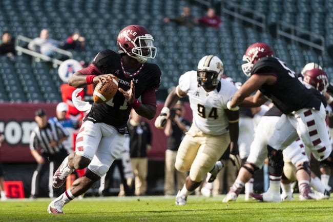 Nov 16, 2013; Philadelphia, PA, USA; Temple Owls quarterback P.J. Walker (11) rolls out during the first quarter against the UCF Knights at Lincoln Financial Field. UCF defeated Temple 39-36. Mandatory Credit: Howard Smith-USA TODAY Sports