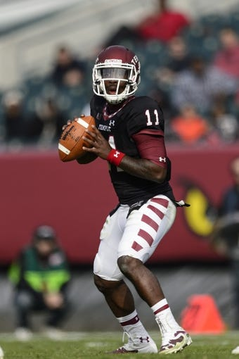 Nov 16, 2013; Philadelphia, PA, USA; Temple Owls quarterback P.J. Walker (11) looks to pass during the second quarter against the UCF Knights at Lincoln Financial Field. UCF defeated Temple 39-36. Mandatory Credit: Howard Smith-USA TODAY Sports