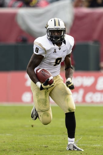 Nov 16, 2013; Philadelphia, PA, USA; UCF Knights running back Storm Johnson (8) carries the ball during the second quarter against the Temple Owls at Lincoln Financial Field. UCF defeated Temple 39-36. Mandatory Credit: Howard Smith-USA TODAY Sports