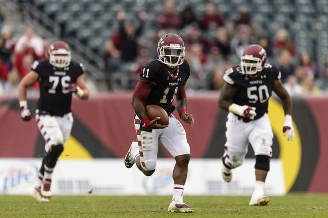 Nov 16, 2013; Philadelphia, PA, USA; Temple Owls quarterback P.J. Walker (11) carries the ball during the fourth quarter against the UCF Knights at Lincoln Financial Field. UCF defeated Temple 39-36. Mandatory Credit: Howard Smith-USA TODAY Sports