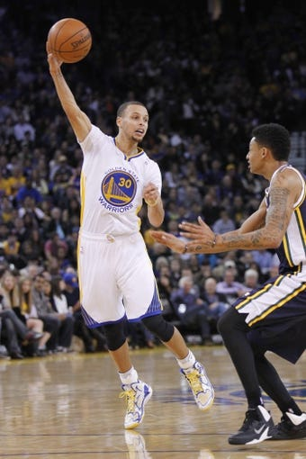 Nov 16, 2013; Oakland, CA, USA; Golden State Warriors guard Stephen Curry (30) passes the ball against the Utah Jazz in the first quarter at Oracle Arena. Mandatory Credit: Cary Edmondson-USA TODAY Sports
