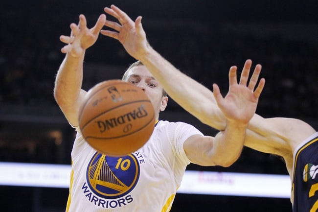 Nov 16, 2013; Oakland, CA, USA; Golden State Warriors forward David Lee (10) fights for a loose ball against the Utah Jazz in the second quarter at Oracle Arena. Mandatory Credit: Cary Edmondson-USA TODAY Sports