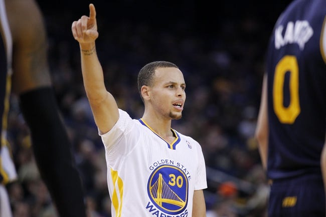 Nov 16, 2013; Oakland, CA, USA; Golden State Warriors guard Stephen Curry (30) points towards the hoop against the Utah Jazz in the second quarter at Oracle Arena. Mandatory Credit: Cary Edmondson-USA TODAY Sports