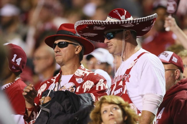 Nov 16, 2013; Starkville, MS, USA; Alabama Crimson Tide fans during the game against the Mississippi State Bulldogs at Davis Wade Stadium. Alabama Crimson Tide defeat the Mississippi State Bulldogs with a score of 20-7.  Mandatory Credit: Spruce Derden-USA TODAY Sports
