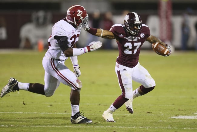 Nov 16, 2013; Starkville, MS, USA; Mississippi State Bulldogs running back LaDarius Perkins (27) advances the ball and stiff arms Alabama Crimson Tide linebacker C.J. Mosley (32) during the game at Davis Wade Stadium. Alabama Crimson Tide defeat the Mississippi State Bulldogs with a score of 20-7.  Mandatory Credit: Spruce Derden-USA TODAY Sports