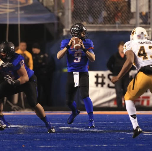 Nov 16, 2013; Boise, ID, USA; Boise State Broncos quarterback Grant Hedrick (9) looks down field for a receiver during the first half against the Wyoming Cowboys at Bronco Stadium. Mandatory Credit: Brian Losness-USA TODAY Sports