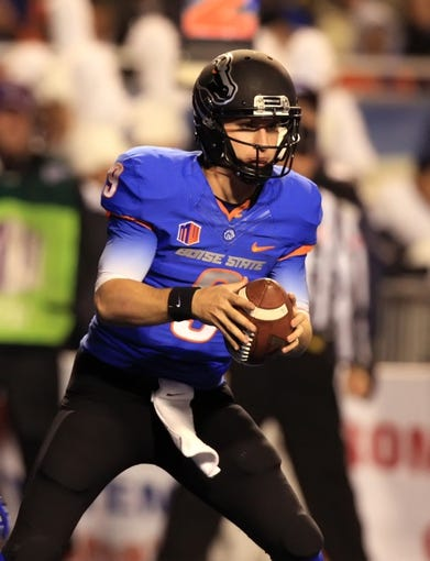 Nov 16, 2013; Boise, ID, USA; Boise State Broncos quarterback Grant Hedrick (9) during the first half against the Wyoming Cowboys at Bronco Stadium. Mandatory Credit: Brian Losness-USA TODAY Sports