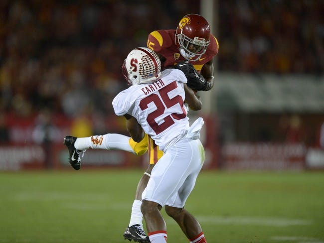 Nov 16, 2013; Los Angeles, CA, USA; Southern California Trojans receiver Nelson Agholor (15) is defended by Stanford Cardinal cornerback Alex Carter (25) on a 26-yard reception at Los Angeles Memorial Coliseum. Mandatory Credit: Kirby Lee-USA TODAY Sports