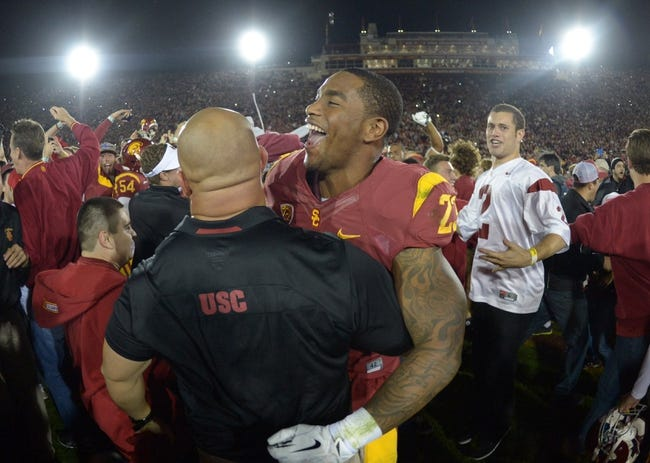 Nov 16, 2013; Los Angeles, CA, USA; Southern California Trojans tailback Tre Madden (23) celebrates at the end of the game against the Stanford Cardinal at Los Angeles Memorial Coliseum. USC defeated Stanford 20-17. Mandatory Credit: Kirby Lee-USA TODAY Sports