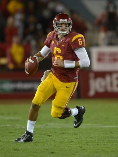 Nov 16, 2013; Los Angeles, CA, USA; Southern California Trojans quarterback Cody Kessler (6) throws a pass against the Stanford Cardinal at Los Angeles Memorial Coliseum. Mandatory Credit: Kirby Lee-USA TODAY Sports