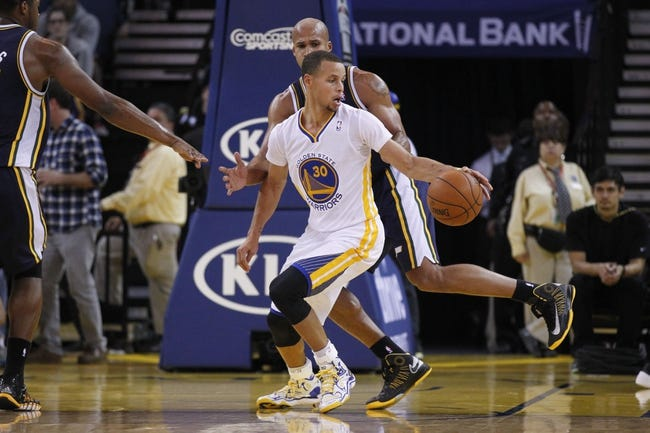 Nov 16, 2013; Oakland, CA, USA; Golden State Warriors guard Stephen Curry (30) dribbles the ball against the Utah Jazz in the third quarter at Oracle Arena. The Warriors defeated the Jazz 102-88. Mandatory Credit: Cary Edmondson-USA TODAY Sports