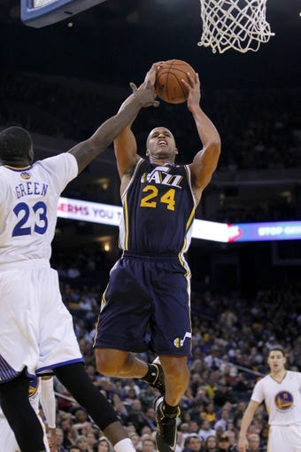 Nov 16, 2013; Oakland, CA, USA; Utah Jazz forward Richard Jefferson (24) attempts a shot over Golden State Warriors forward Draymond Green (23) in the third quarter at Oracle Arena. The Warriors defeated the Jazz 102-88. Mandatory Credit: Cary Edmondson-USA TODAY Sports