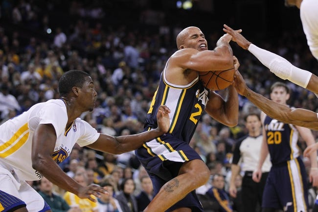 Nov 16, 2013; Oakland, CA, USA; Utah Jazz forward Richard Jefferson (24) has the ball knocked out of his hands while driving to the hoop against the Golden State Warriors in the fourth quarter at Oracle Arena. The Warriors defeated the Jazz 102-88. Mandatory Credit: Cary Edmondson-USA TODAY Sports