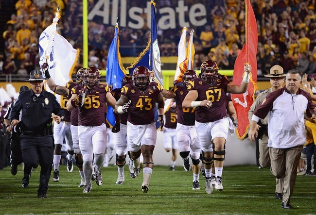 Nov 16, 2013; Tempe, AZ, USA; Arizona State Sun Devils defensive end Gannon Conway (95) , defensive end Davon Coleman (43) , and center Kody Koebensky (67) run out onto the field with teammates prior to the game against Oregon State Beavers at Sun Devil Stadium. The Devils defeated the Beavers 30-17. Mandatory Credit: Jennifer Stewart-USA TODAY Sports