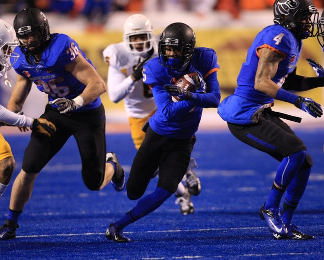 Nov 16, 2013; Boise, ID, USA; Boise State Broncos cornerback Donte Deayon (5) return an interception  during the second half against the Wyoming Cowboys at Bronco Stadium. Boise State defeated Wyoming 48-7. Mandatory Credit: Brian Losness-USA TODAY Sports