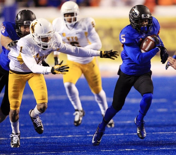 Nov 16, 2013; Boise, ID, USA; Boise State Broncos cornerback Donte Deayon (5) runs away from Wyoming Cowboys wide receiver Jalen Claiborne (1) after making an interception during the second half at Bronco Stadium. Boise State defeated Wyoming 48-7. Mandatory Credit: Brian Losness-USA TODAY Sports