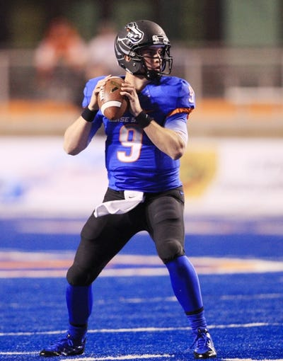 Nov 16, 2013; Boise, ID, USA; Boise State Broncos quarterback Grant Hedrick (9) during the second half against the Wyoming Cowboys at Bronco Stadium. Boise State defeated Wyoming 48-7. Mandatory Credit: Brian Losness-USA TODAY Sports
