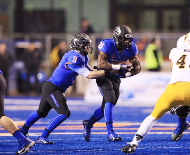 Nov 16, 2013; Boise, ID, USA; Boise State Broncos running back Jack Fields (21) takes a hand off from quarterback Grant Hedrick (9) during the second half against the Wyoming Cowboys at Bronco Stadium. Boise State defeated Wyoming 48-7. Mandatory Credit: Brian Losness-USA TODAY Sports
