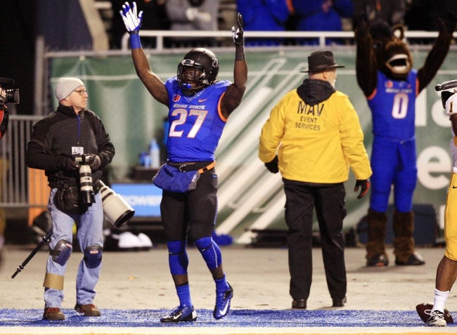 Nov 16, 2013; Boise, ID, USA; Boise State Broncos running back Jay Ajayi (27) celebrates his touchdown during the second half against the Wyoming Cowboys at Bronco Stadium. Boise State defeated Wyoming 48-7. Mandatory Credit: Brian Losness-USA TODAY Sports