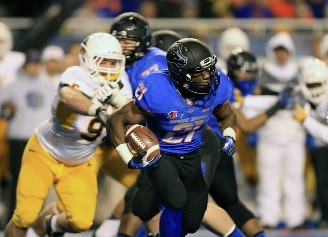 Nov 16, 2013; Boise, ID, USA; Boise State Broncos running back Jack Fields (21) runs for a first down during the second half against the Wyoming Cowboys at Bronco Stadium. Boise State defeated Wyoming 48-7. Mandatory Credit: Brian Losness-USA TODAY Sports