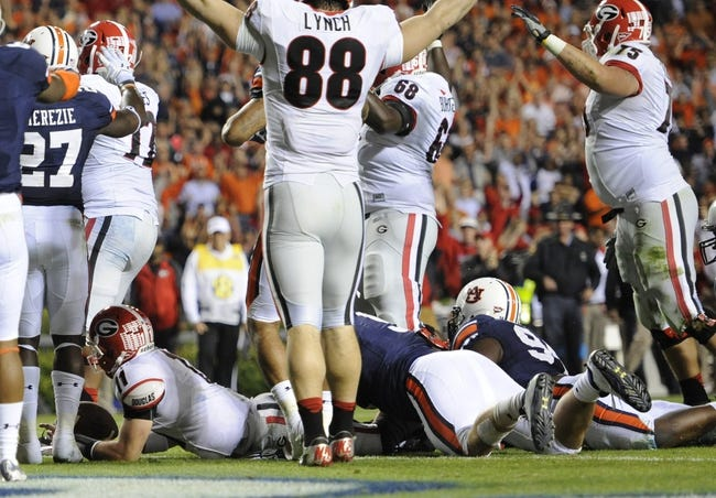 Nov 16, 2013; Auburn, AL, USA; (Editors note: Caption correction) Georgia Bulldogs quarterback Aaron Murray (11) scores a touchdown that underwent review by the Auburn Tigers at Jordan Hare Stadium. The play was ruled a touchdown. The Tigers defeated the Bulldogs 43-38. Mandatory Credit: Shanna Lockwood-USA TODAY Sports