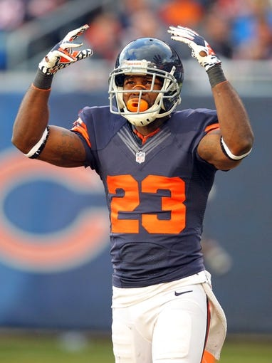 Nov 17, 2013; Chicago, IL, USA; Chicago Bears wide receiver Devin Hester (23) cheers on the crowd during the first half against the Baltimore Ravens at Soldier Field. Mandatory Credit: Dennis Wierzbicki-USA TODAY Sports