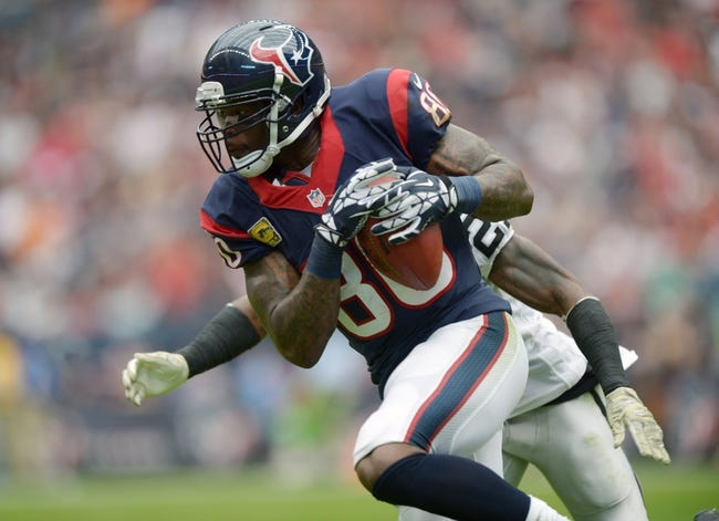 Nov 17, 2013; Houston, TX, USA; Houston Texans receiver Andre Johnson (80) is pursued by Oakland Raiders cornerback Mike Jenkins (21) at Reliant Stadium. The Raiders defeated the Texans 28-23. Mandatory Credit: Kirby Lee-USA TODAY Sports