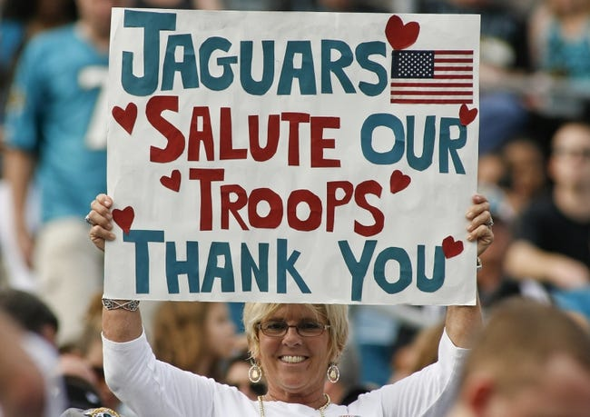 Nov 17, 2013; Jacksonville, FL, USA; A Jacksonville Jaguars holds up a sign in support of US troops in the fourth quarter of their game against the Arizona Cardinals at EverBank Field. The Arizona Cardinals beat the Jacksonville Jaguars 27-14. Mandatory Credit: Phil Sears-USA TODAY Sports