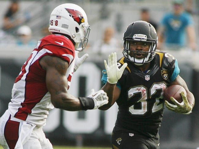 Nov 17, 2013; Jacksonville, FL, USA; Jacksonville Jaguars running back Maurice Jones-Drew (32) gets ready to stiff arm Arizona Cardinals linebacker Daryl Washington (58) in the fourth quarter of their game at EverBank Field. The Arizona Cardinals beat the Jacksonville Jaguars 27-14. Mandatory Credit: Phil Sears-USA TODAY Sports