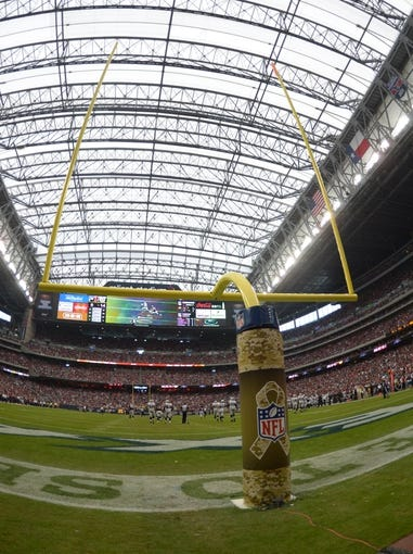 Nov 17, 2013; Houston, TX, USA; General view of the goal posts with the NFL salute to service logo during the game between the Oakland Raiders and the Houston Texans at Reliant Stadium. Mandatory Credit: Kirby Lee-USA TODAY Sports
