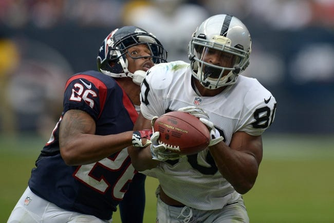 Nov 17, 2013; Houston, TX, USA; Oakland Raiders receiver Rod Streater (80) is defended by Houston Texans cornerback Brandon Harris (26) on a 36-yard reception in the third quarter at Reliant Stadium. The Raiders defeated the Texans 28-23. Mandatory Credit: Kirby Lee-USA TODAY Sports