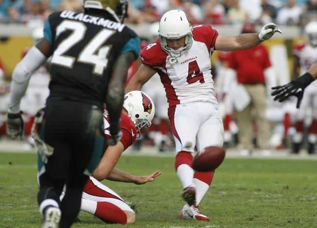 Nov 17, 2013; Jacksonville, FL, USA; Arizona Cardinals placekicker Jay Feely (4) kicks a 32-yard field goal in the fourth quarter of their game against the Jacksonville Jaguars at EverBank Field. The Arizona Cardinals beat the Jacksonville Jaguars 27-14. Mandatory Credit: Phil Sears-USA TODAY Sports