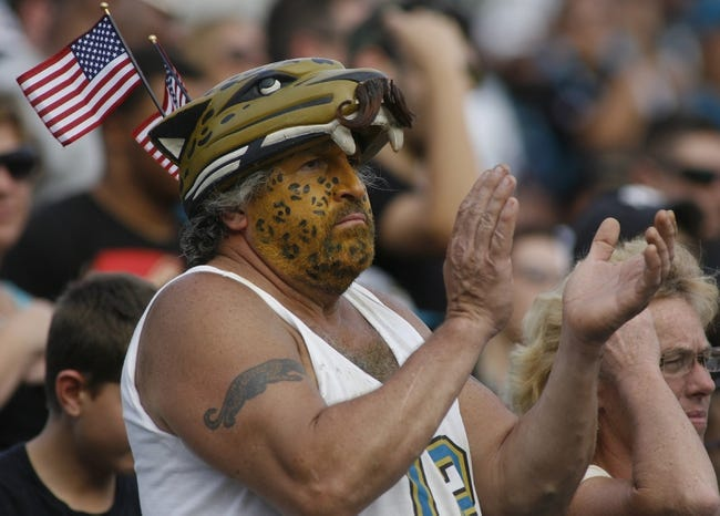 Nov 17, 2013; Jacksonville, FL, USA; A Jacksonville Jaguars fan claps in the fourth quarter of their game against the Arizona Cardinals at EverBank Field. The Arizona Cardinals beat the Jacksonville Jaguars 27-14. Mandatory Credit: Phil Sears-USA TODAY Sports