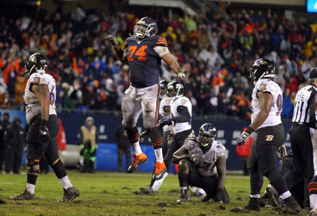 Nov 17, 2013; Chicago, IL, USA; Chicago Bears tackle Jermon Bushrod (74) celebrates the victory during overtime against the Baltimore Ravens at Soldier Field. Chicago won 23-20 in overtime. Mandatory Credit: Dennis Wierzbicki-USA TODAY Sports