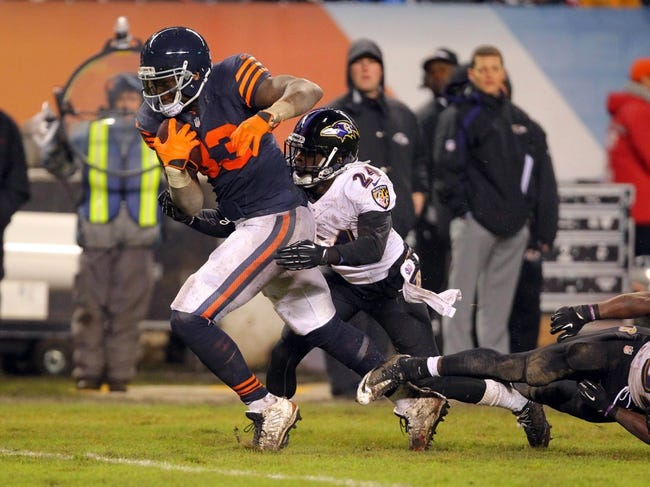 Nov 17, 2013; Chicago, IL, USA; Chicago Bears tight end Martellus Bennett (83) catches a 43 yard pass during overtime with Baltimore Ravens cornerback Corey Graham (24) defending at Soldier Field. Chicago won 23-20 in overtime. Mandatory Credit: Dennis Wierzbicki-USA TODAY Sports