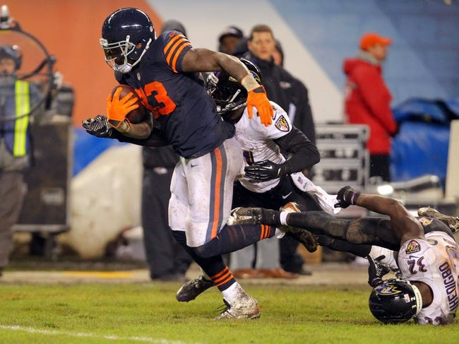 Nov 17, 2013; Chicago, IL, USA; Chicago Bears tight end Martellus Bennett (83) catches a 43 yard pass during overtime with Baltimore Ravens cornerback Corey Graham (24) and strong safety James Ihedigbo (32) defending at Soldier Field. Chicago won 23-20 in overtime. Mandatory Credit: Dennis Wierzbicki-USA TODAY Sports