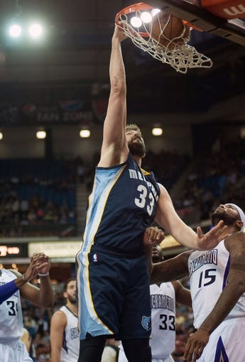 Nov 17, 2013; Sacramento, CA, USA; Memphis Grizzlies center Marc Gasol (33) dunks the ball against the Sacramento Kings during the first quarter at Sleep Train Arena. Mandatory Credit: Ed Szczepanski-USA TODAY Sports