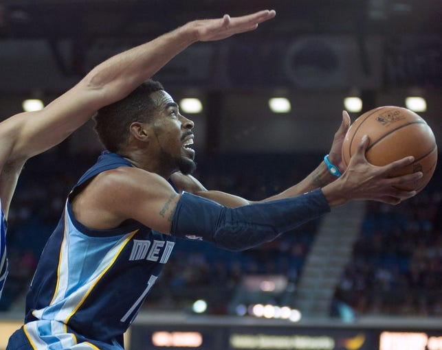 Nov 17, 2013; Sacramento, CA, USA; Memphis Grizzlies point guard Mike Conley (11) takes a shot against the Sacramento Kings during the second quarter at Sleep Train Arena. Mandatory Credit: Ed Szczepanski-USA TODAY Sports
