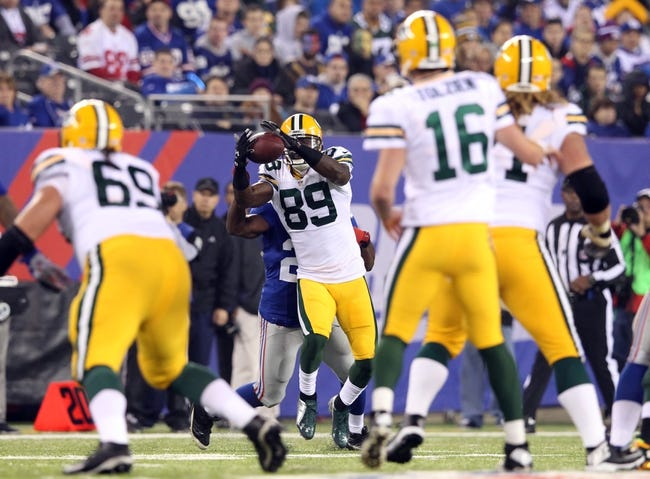 Nov 17, 2013; East Rutherford, NJ, USA; Green Bay Packers wide receiver James Jones (89) makes a catch against the New York Giants during the fourth quarter of a game at MetLife Stadium. Mandatory Credit: Brad Penner-USA TODAY Sports