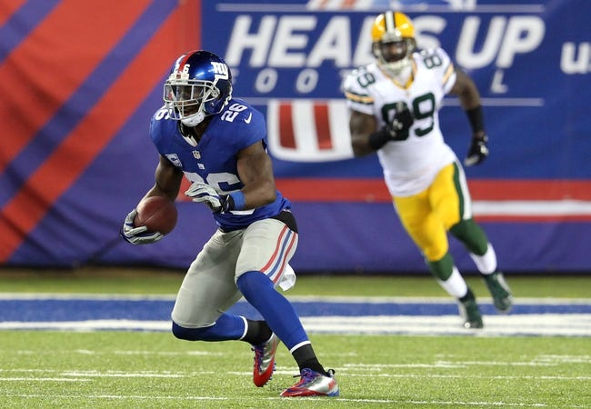 Nov 17, 2013; East Rutherford, NJ, USA; New York Giants safety Antrel Rolle (26) runs back an interception against the Green Bay Packers during the fourth quarter of a game at MetLife Stadium. Mandatory Credit: Brad Penner-USA TODAY Sports