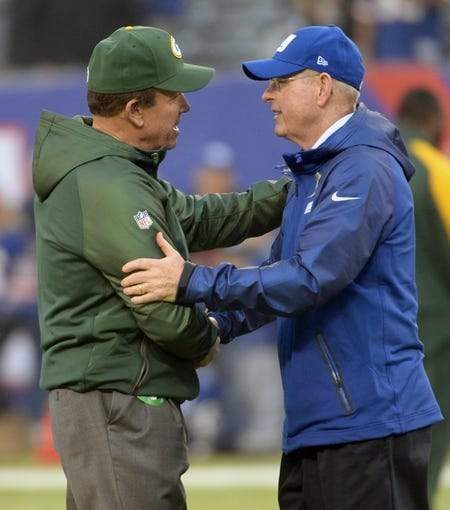 Nov 17, 2013; East Rutherford, NJ, USA; Green Bay Packers head coach Mike McCarthy and New York Giants head coach Tom Coughlin, meet pre game at MetLife Stadium. Mandatory Credit: Robert Deutsch-USA TODAY Sports