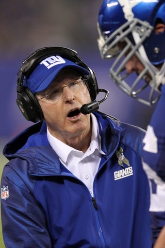 Nov 17, 2013; East Rutherford, NJ, USA; New York Giants head coach Tom Coughlin talks to New York Giants offensive tackle David Diehl (66) after a touchdown against the Green Bay Packers during the third quarter of a game at MetLife Stadium. Mandatory Credit: Brad Penner-USA TODAY Sports