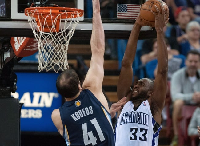 Nov 17, 2013; Sacramento, CA, USA; Sacramento Kings power forward Luc Richard Mbah a Moute (33) attempts to dunk the ball on Memphis Grizzlies center Kosta Koufos (41) during the second quarter at Sleep Train Arena. The Memphis Grizzlies defeated the Sacramento Kings 97-86. Mandatory Credit: Ed Szczepanski-USA TODAY Sports