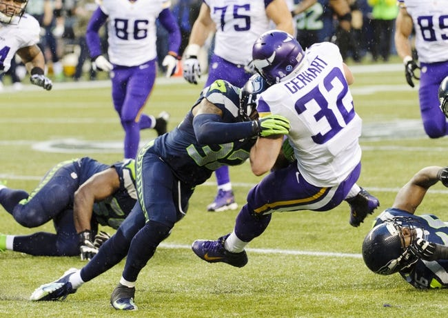 Nov 17, 2013; Seattle, WA, USA; Seattle Seahawks strong safety Jeron Johnson (32) tackles Minnesota Vikings running back Toby Gerhart (32) during the second half at CenturyLink Field. Seattle defeated Minnesota 41-20. Mandatory Credit: Steven Bisig-USA TODAY Sports