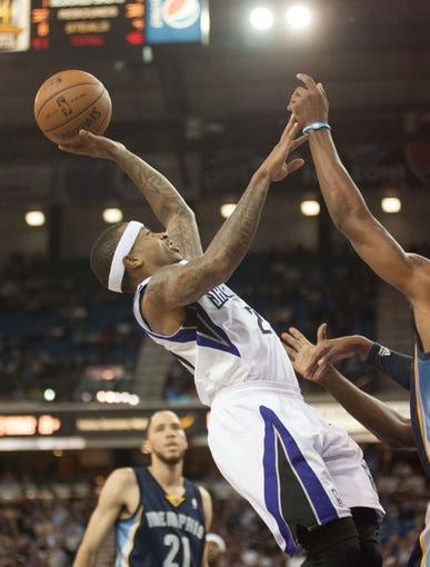 Nov 17, 2013; Sacramento, CA, USA; Sacramento Kings point guard Isaiah Thomas (22) takes a shot against the Memphis Grizzlies during the third quarter at Sleep Train Arena.  The Memphis Grizzlies defeated the Sacramento Kings 97-86. Mandatory Credit: Ed Szczepanski-USA TODAY Sports
